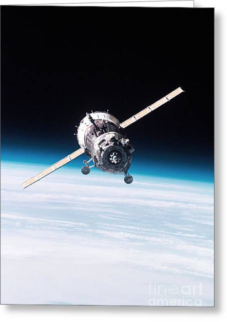 Roberto Greeting Cards - Iss Crew Arriving By Soyuz Spacecraft Greeting Card by NASA / Science Source
