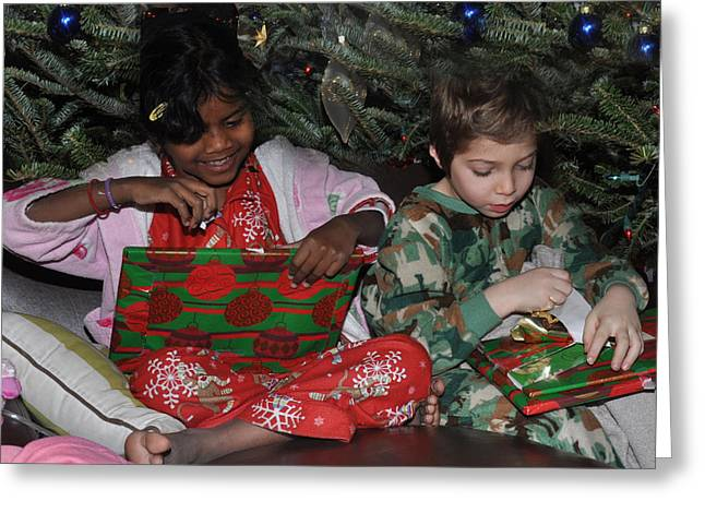 Pajamas Greeting Cards - Kids open Christmas gifts Greeting Card by Diane Lent