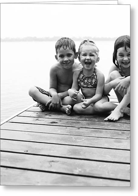 Swimsuit Photography Greeting Cards - Kids Sitting On Dock Greeting Card by Michelle Quance