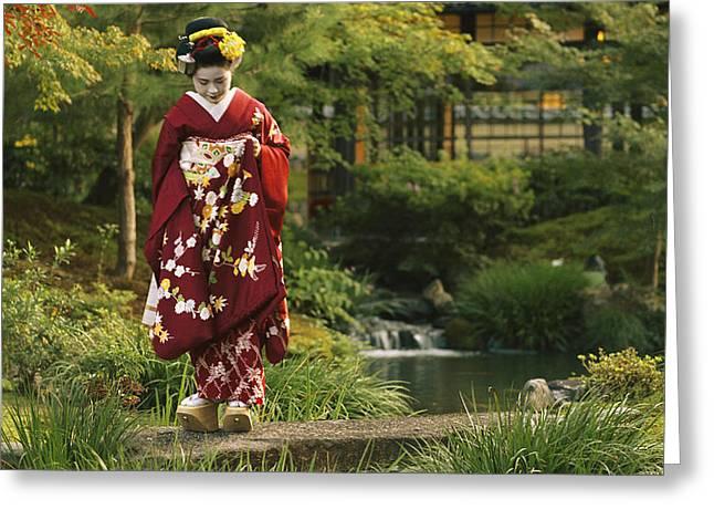 Kimono-clad Geisha In A Park Greeting Card by Justin Guariglia