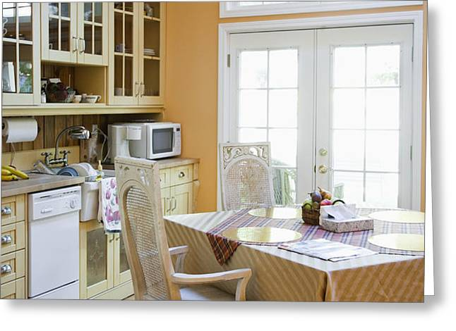 Kitchen Cabinets and Table Greeting Card by Andersen Ross