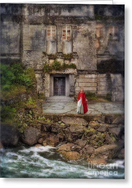 Young Lady Greeting Cards - Lady in Red Cape By an Old House by the Sea Greeting Card by Jill Battaglia