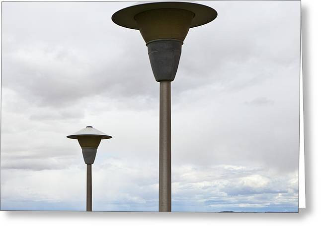 Overcast Day Greeting Cards - Lamp Posts in the Desert Greeting Card by Paul Edmondson