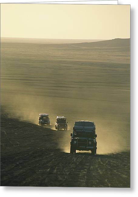 Dust Clouds Greeting Cards - Land Rovers Kick Up Dust On The Old Greeting Card by Bobby Model