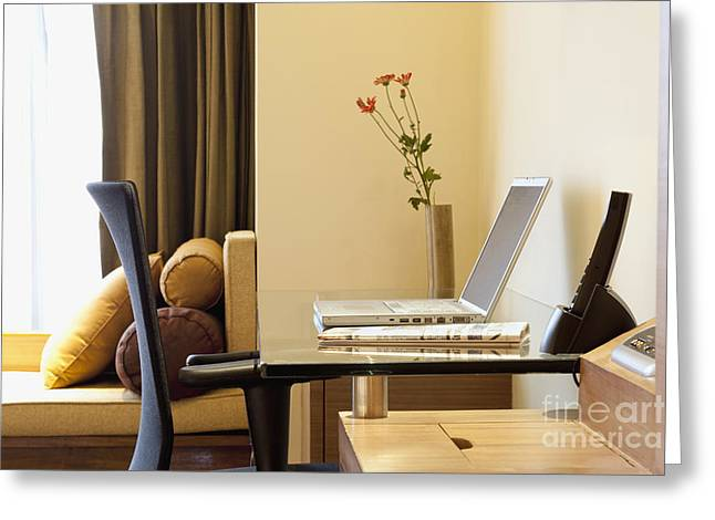 Home Office Furniture Greeting Cards - Laptop at a Desk Greeting Card by Inti St. Clair