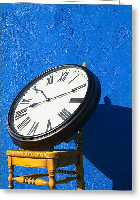 Clock Photographs Greeting Cards - Large clock on yellow chair Greeting Card by Garry Gay