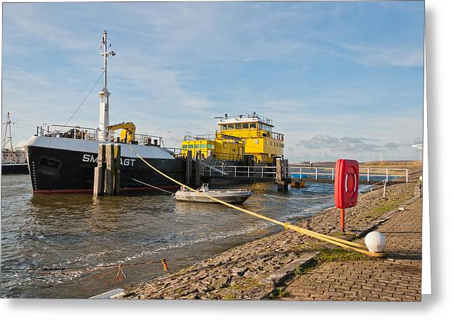 Moerdijk Greeting Cards - Large ship moored at a small port Greeting Card by Ruud Morijn