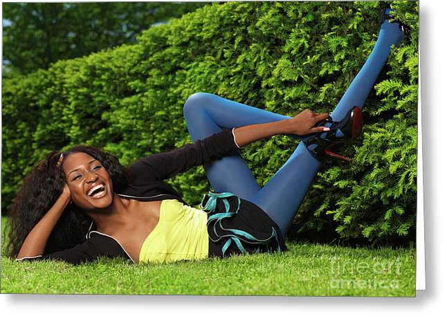 Legs Up Greeting Cards - Laughing Young Woman Lying on the Grass Greeting Card by Oleksiy Maksymenko