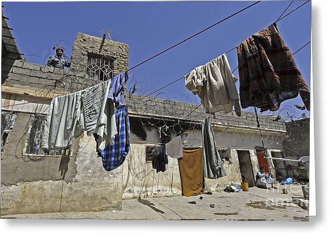 Laundry Hangs In The Courtyard Greeting Card by Stocktrek Images