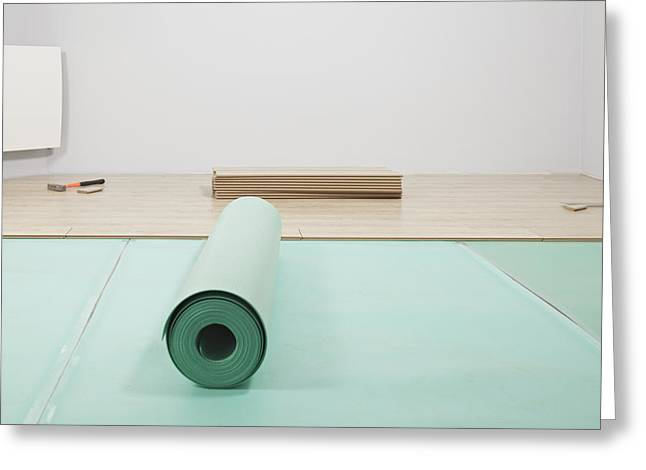Laying A Floor. A Roll Of Underlay Or Greeting Card by Magomed Magomedagaev