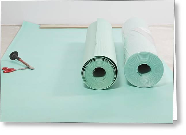 Laying A Floor. Rolls Of Underlay Or Greeting Card by Magomed Magomedagaev