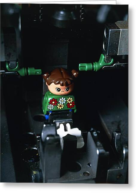 Lego Greeting Cards - Lego Doll In An Assembly Machine Greeting Card by Volker Steger