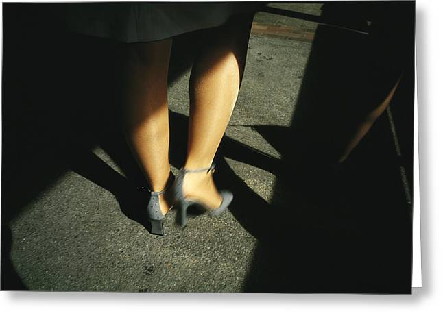 Light And Dark Greeting Cards - Legs Of A Walking Woman Wearing Greeting Card by Justin Guariglia