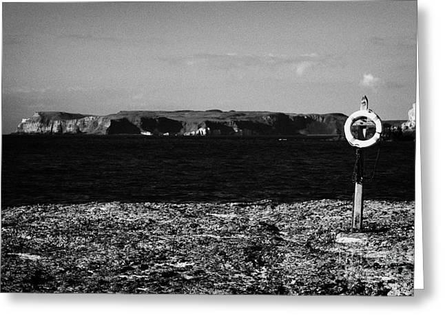 Lifebelt On Rocks At Ballintoy With Moyle Sea And Rathlin Island Greeting Card by Joe Fox