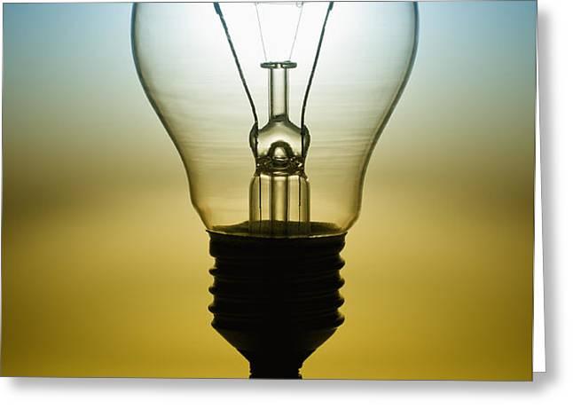 light bulb Greeting Card by Setsiri Silapasuwanchai