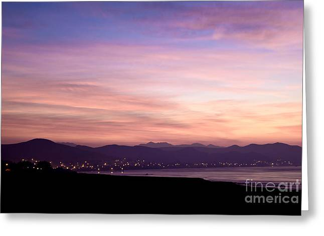 Beach At Night Greeting Cards - Lights Emanating From City in Distance Greeting Card by David Buffington
