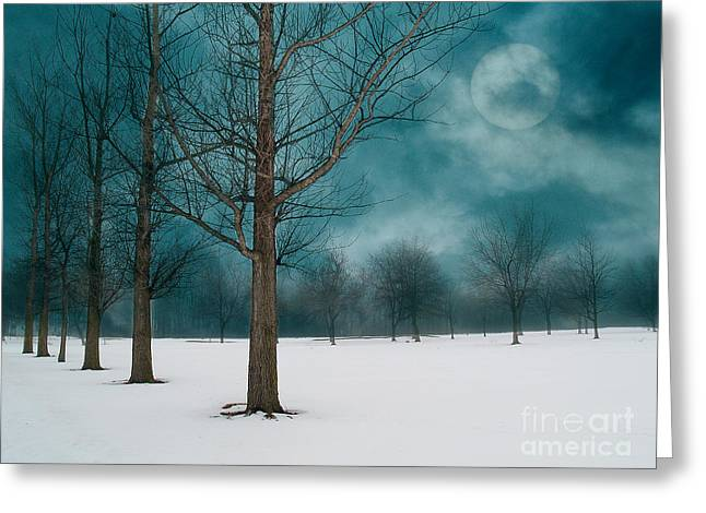 Line Of Trees Border A Snowy Field With A Rising Moon In A Cloudy Sky.  Greeting Card by Emilio Lovisa