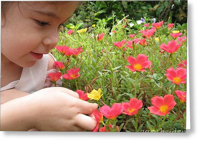 Experienced In Childhood Greeting Cards - Little Girl Admiring Flowers Greeting Card by Gary Heiden