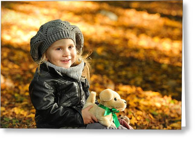 Doggy Clothes Greeting Cards - Little girl in autumn leaves Greeting Card by Waldek Dabrowski