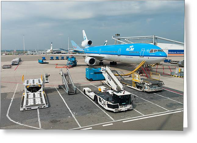 Klm Greeting Cards - Loading a KLM plane Greeting Card by Hans Engbers
