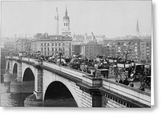 London Bridge showing carriages - coaches and pedestrian traffic - c 1900 Greeting Card by International  Images