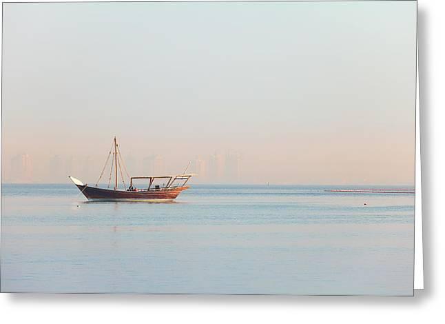 Arabian Pastels Greeting Cards - Lone dhow in Qatar Greeting Card by Paul Cowan