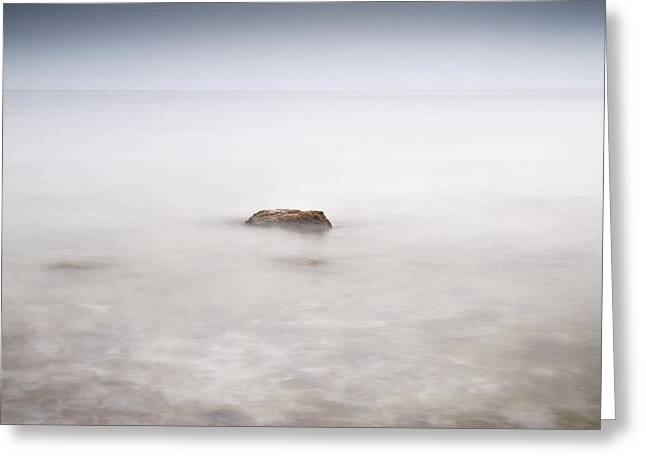 Foggy Beach Greeting Cards - Lonely rock at the silver sea Greeting Card by Guido Montanes Castillo