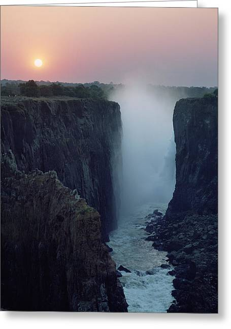 Zambia Waterfall Greeting Cards - Looking Along Victoria Falls At Dusk Greeting Card by Axiom Photographic
