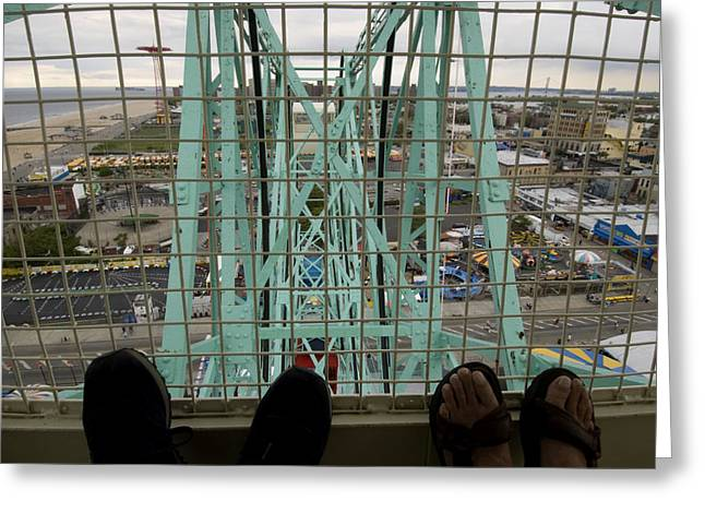 Amusement Ride Greeting Cards - Looking Down At Two Peoples Feet Greeting Card by Todd Gipstein