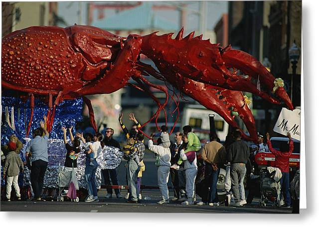 Mixed Age Range Greeting Cards - Louisianans Revel Beneath A Giant Greeting Card by Joel Sartore