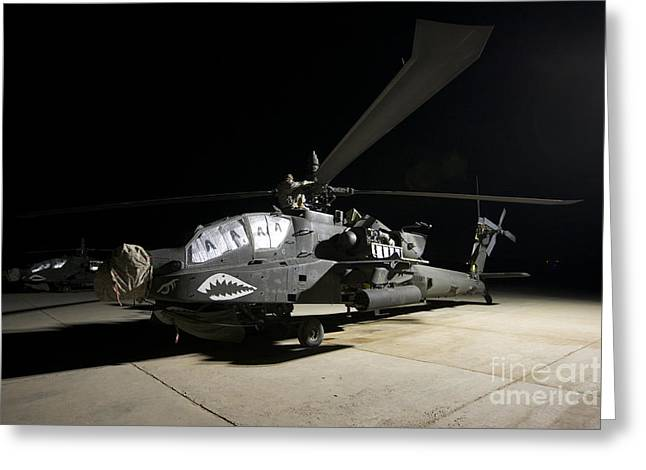 Ah-64 Greeting Cards - Maintenance Crew Work On An Ah-64d Greeting Card by Terry Moore
