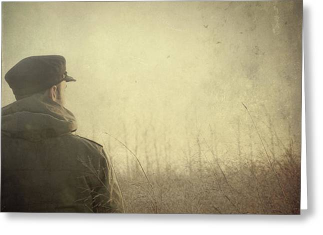 Man alone in Autumn field Greeting Card by Sandra Cunningham
