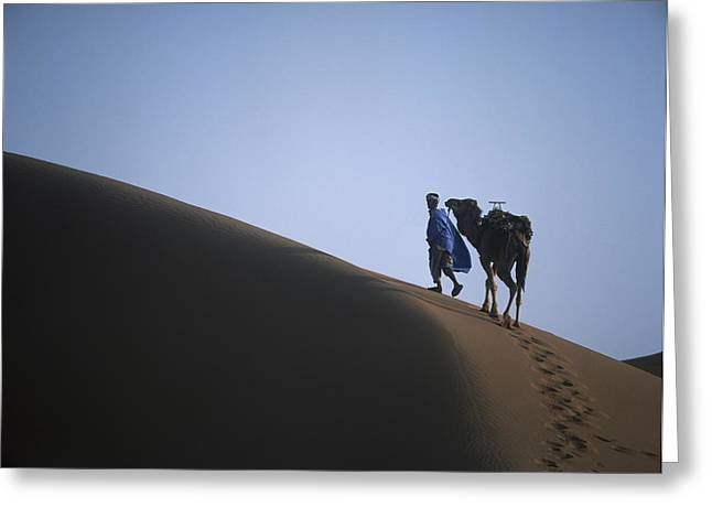 Locals Only Greeting Cards - Man And Camel On Sand Dune Greeting Card by Axiom Photographic