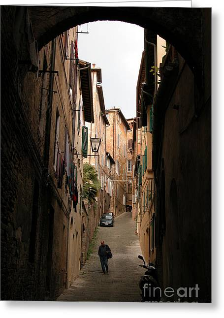 Siena Italy Greeting Cards - Man in street-Siena Greeting Card by Jim Wright