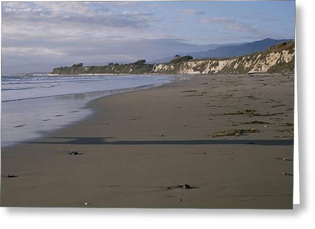 Jogging Greeting Cards - Man Jogs On Sands Beach Below Ellwood Greeting Card by Rich Reid