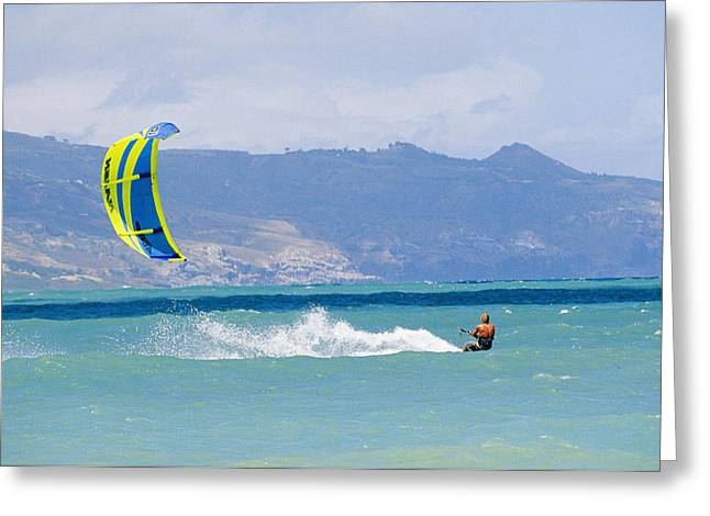 Kiteboarding Greeting Cards - Man Kiteboarding In Turquoise Water Greeting Card by Mark Cosslett