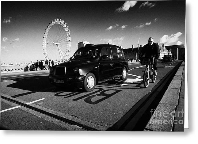 Hackney Greeting Cards - Man On Hired Cycle Being Overtaken By Black London Cab Taxi On Westminster Bridge Greeting Card by Joe Fox