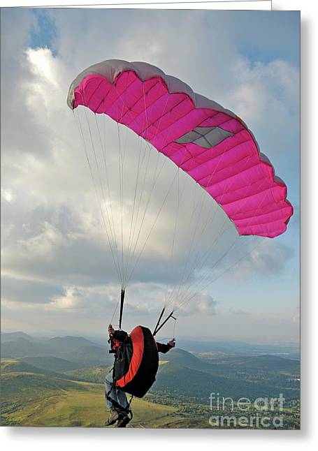 25-29 Years Greeting Cards - Man paragliding off hill Greeting Card by Sami Sarkis