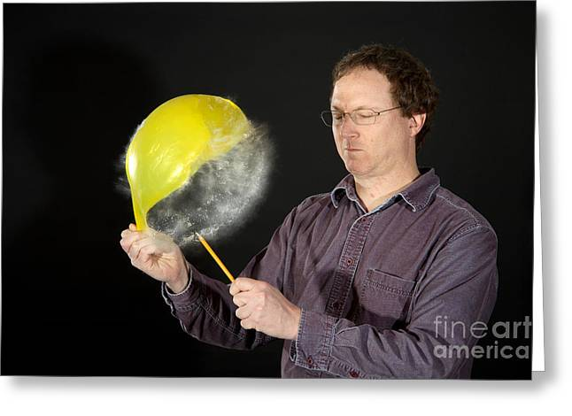 Human Being Photographs Greeting Cards - Man Popping A Balloon Greeting Card by Ted Kinsman