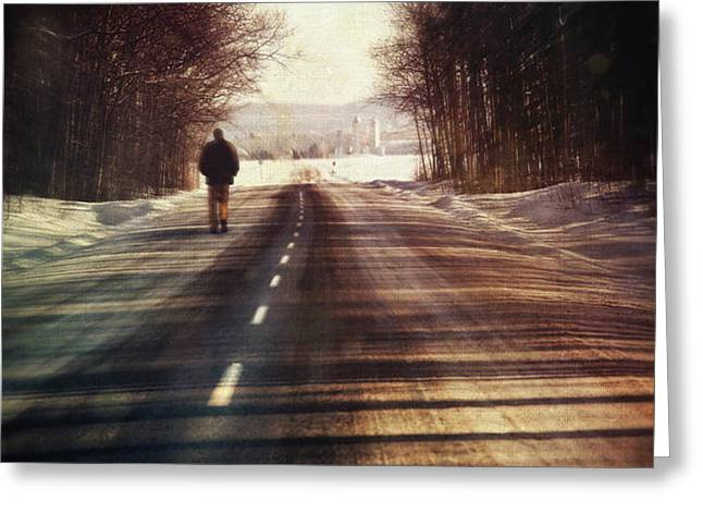 Man walking on a rural winter road Greeting Card by Sandra Cunningham