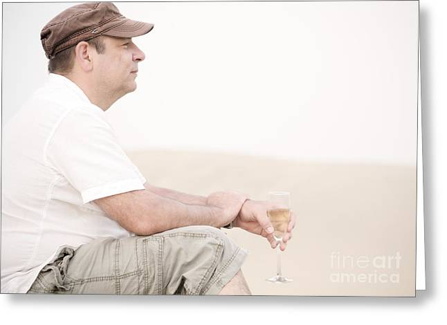 Prosecco Greeting Cards - Man with glass of champagner in the dunes Greeting Card by Iryna Shpulak