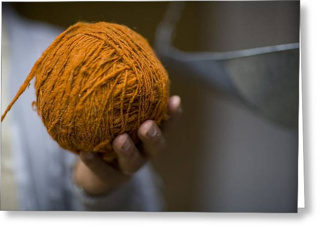 Mans Hand Holds Ball Of Orange Wool Greeting Card by David Evans