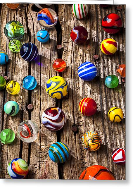 Amusements Greeting Cards - Marbles on wooden board Greeting Card by Garry Gay