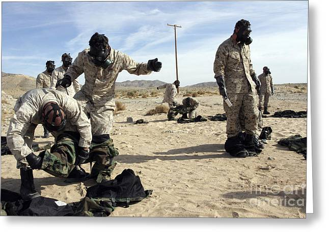 Taking Off Clothes Greeting Cards - Marines And Sailors Assist Each Other Greeting Card by Stocktrek Images