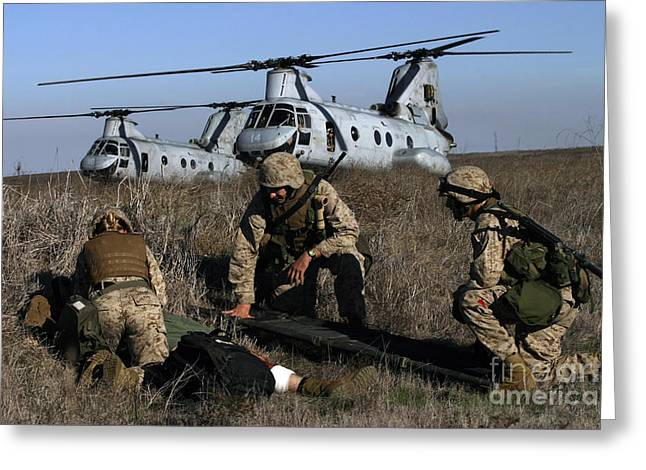 Ch-46 Greeting Cards - Marines And Sailors Being Transported Greeting Card by Stocktrek Images