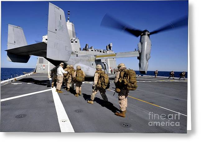 Uss North Carolina Greeting Cards - Marines Board An Mv-22 Osprey Aboard Greeting Card by Stocktrek Images