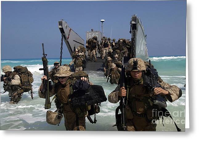 Assault Weapons Greeting Cards - Marines Disembark A Landing Craft Greeting Card by Stocktrek Images