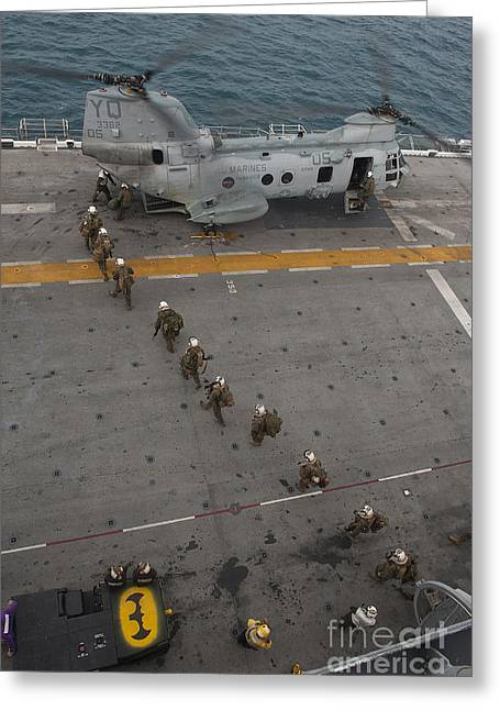 Flight Operations Photographs Greeting Cards - Marines Embark A Ch-46e Sea Stallion Greeting Card by Stocktrek Images
