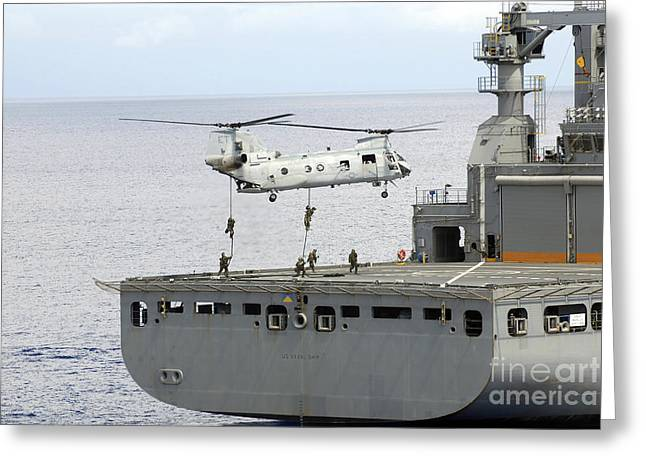 Ch-46 Greeting Cards - Marines Fast Rope From A Ch-46 Sea Greeting Card by Stocktrek Images