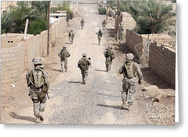 Foot Patrol Greeting Cards - Marines Patrol The Streets Of Iraq Greeting Card by Stocktrek Images